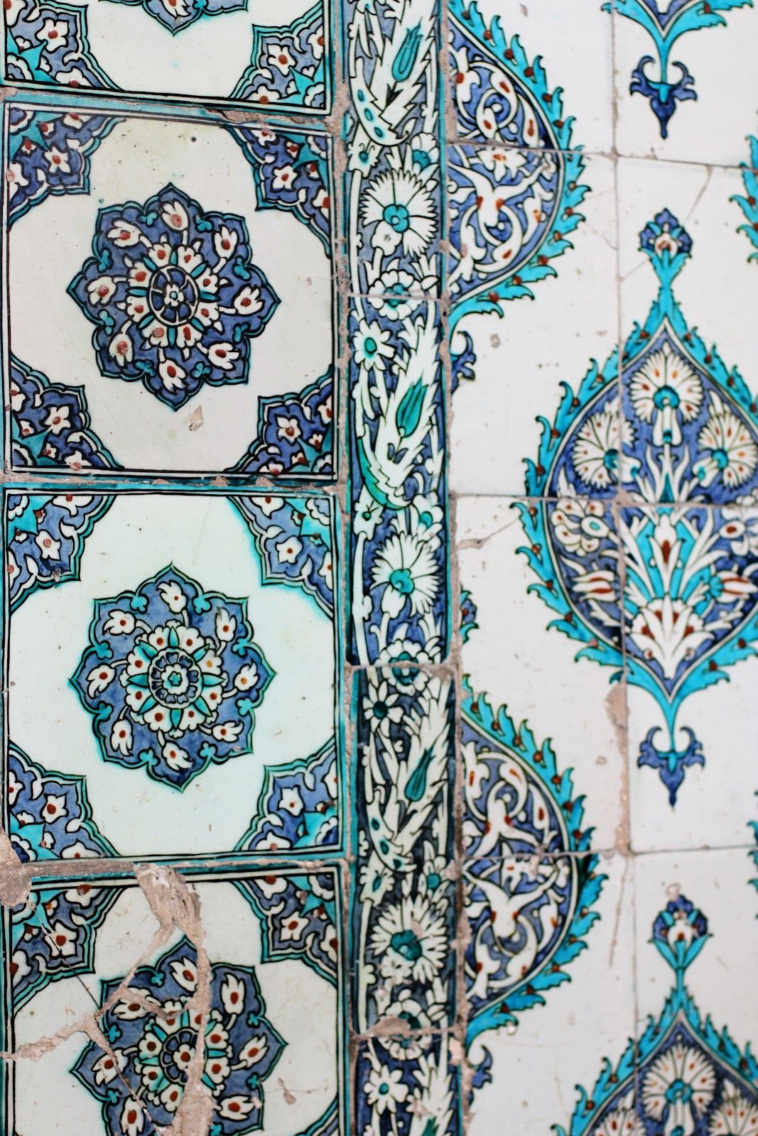 Cobalt blue, turquoise, and white tile in global pattern that almost looks block printed.