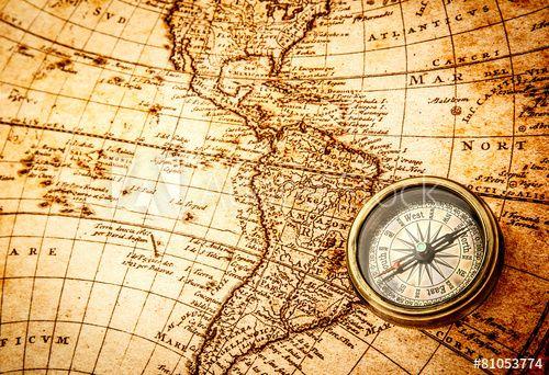 Vintage Compass Lies On An Ancient World Map Ancient World Maps Vintage Compass Vintage Maps