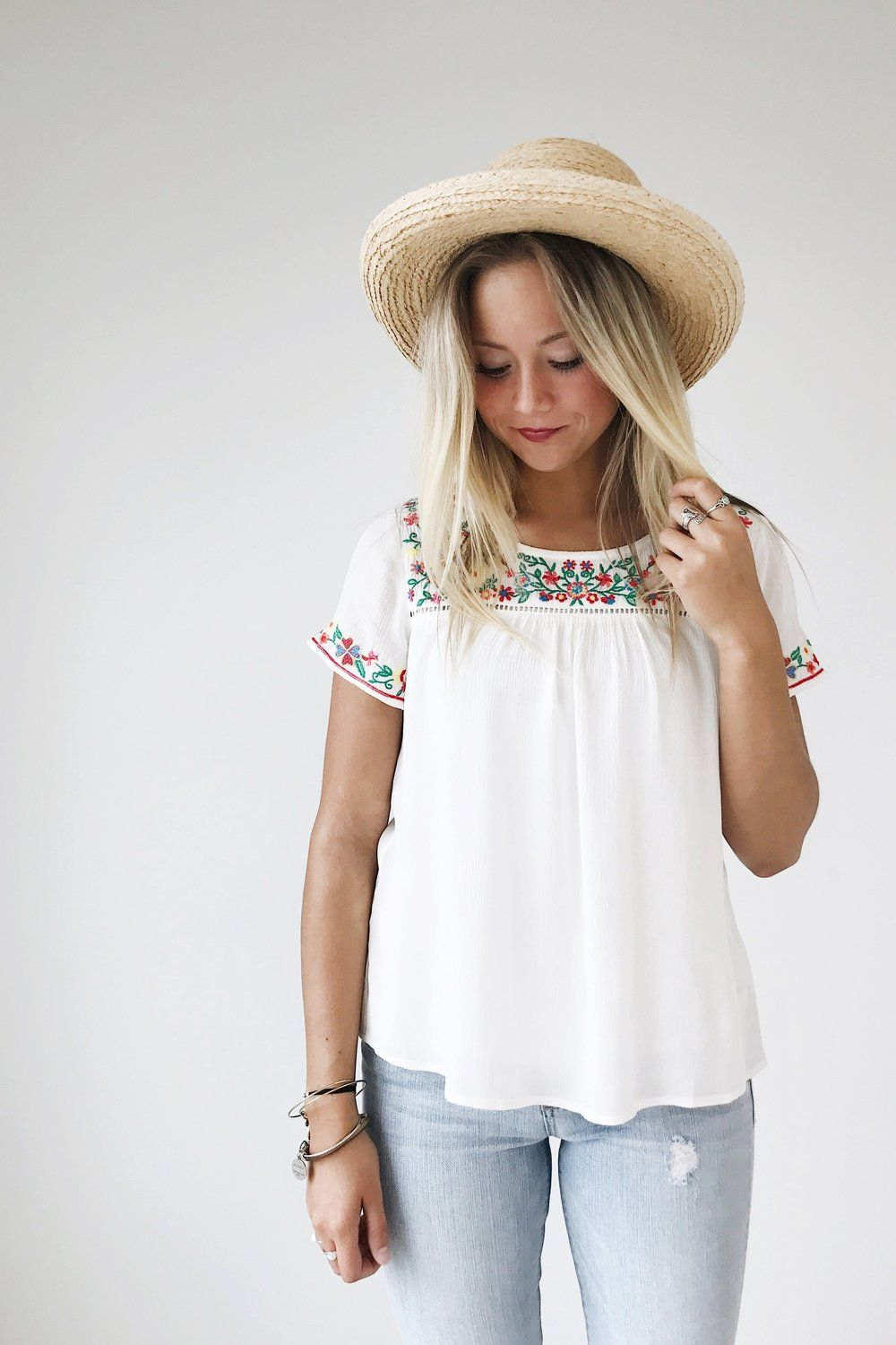"Ivory Blouse Multi-Colored Embroidery Detailed Neckline + Hems Short Sleeved Loose Fit Model is 5'9"" + Wearing a Small"