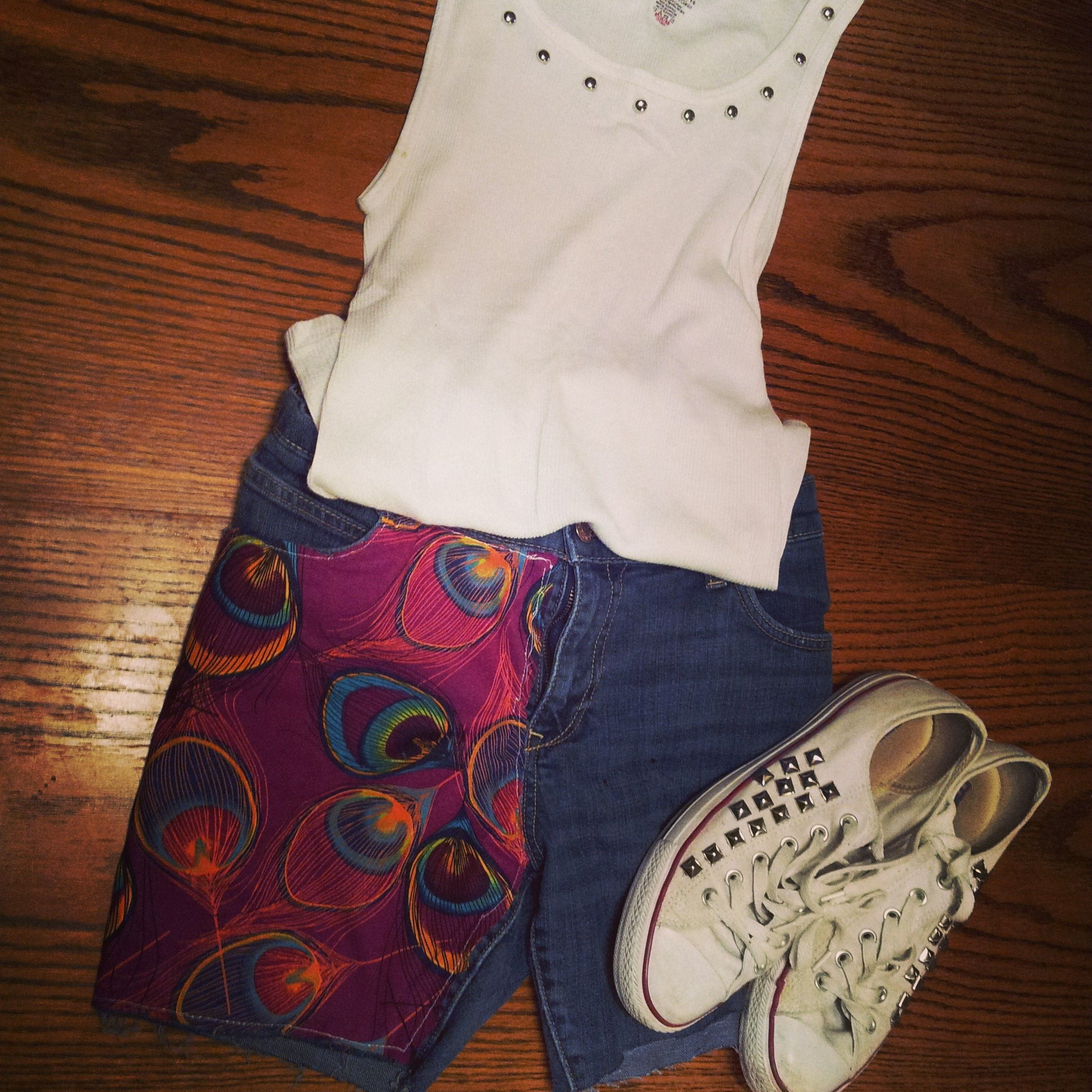 Bright vibrant purple peacock feather fabric machine sewn into front panel of jean shorts $35 studded beater tank top with studded white converse