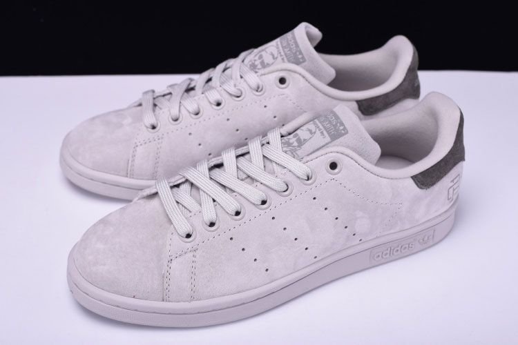 3595462ed Reigning Champ x adidas Originals Stan Smith shoes still use