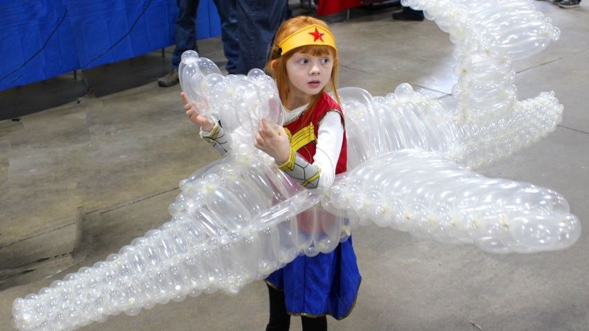 Just Let This Little Girl S Wonder Woman Invisible Jet Costume Win Every Contest Wonder Woman Costume Wonder Woman Cosplay Little Girl Dresses