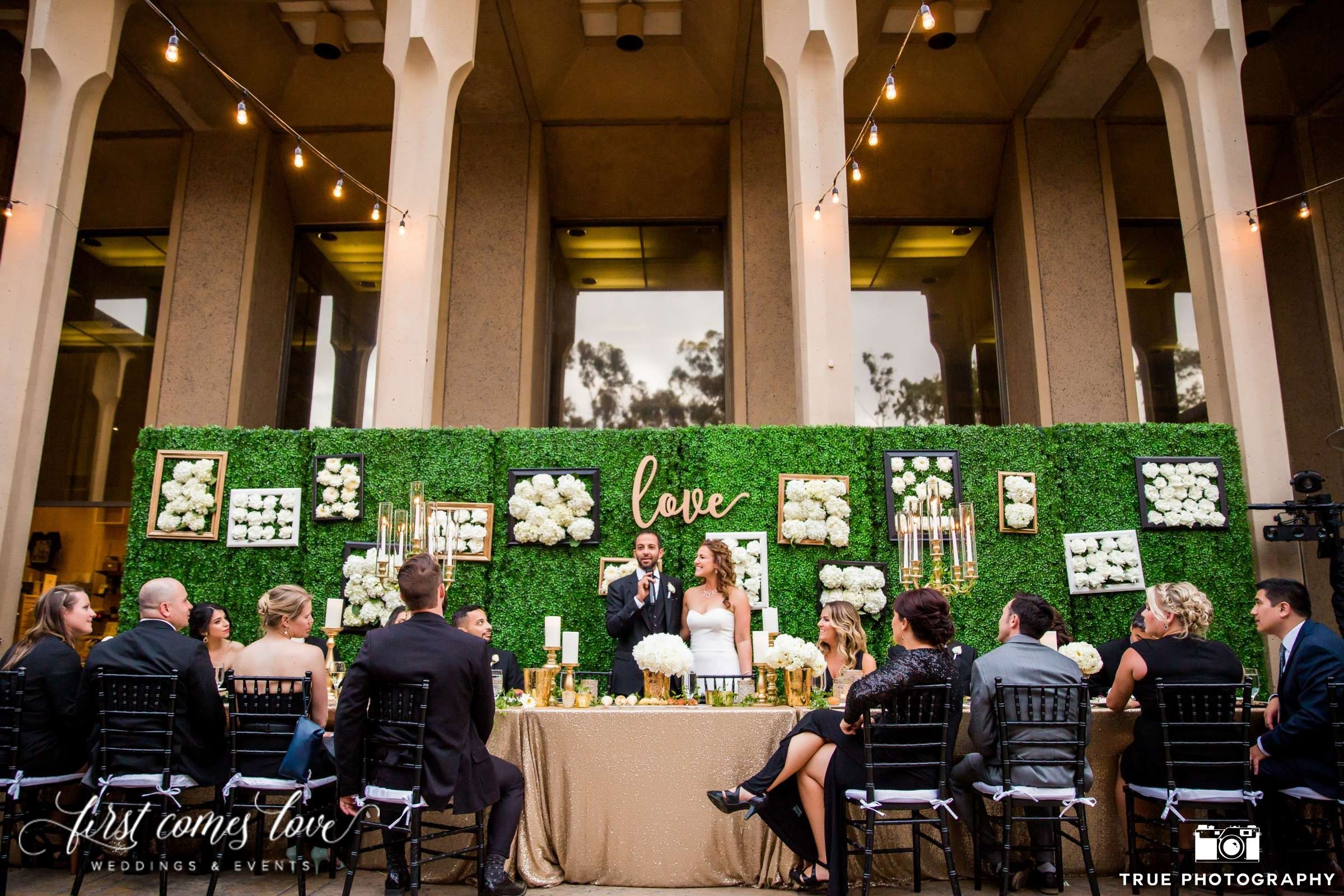 Luxury wedding decoration ideas  Beautiful White and Gold Decor with Vibrant Green Backdrop for a