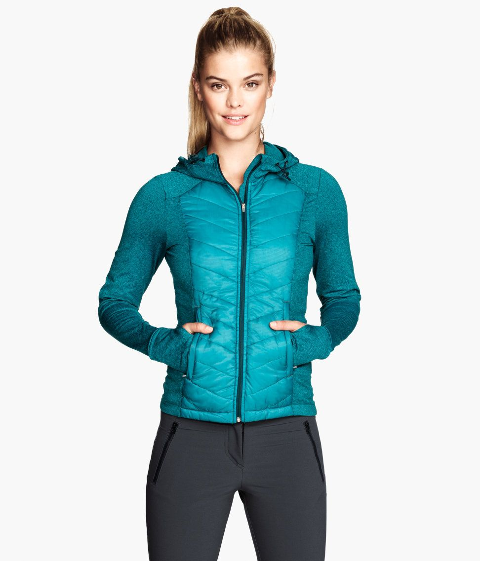 Turquoise fitted fleece jacket with padded front and back sections ...