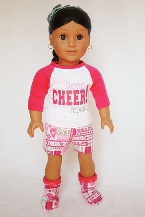 American Girl 18 inch doll - Cheerleader Pajamas #18inchcheerleaderclothes Eat. Sleep. Cheer! Repeat.   If this describes your cheerleader's life, she is going to LOVE these pajamas for her doll!   This adorable 4 piece outfit includes a baseball tee, fleece shorts, matching slipper socks, and a headband.  The pink and white baseball tee features this favorite cheer expression in shades of pink and gray. It closes in the back with a thin strip of Velcro. The soft and fuzzy fleece shorts are prin #18inchcheerleaderclothes