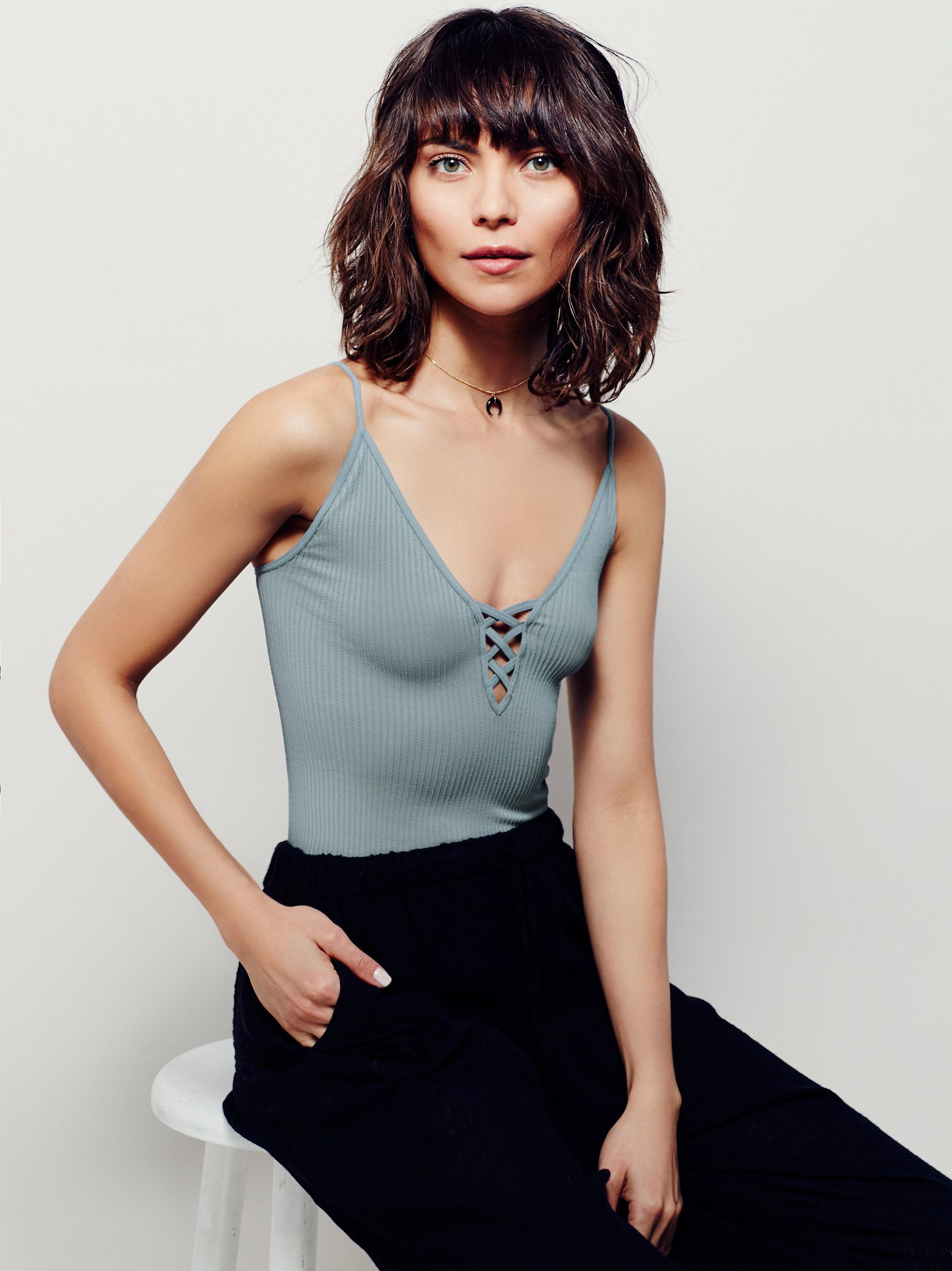 The Crossfire Cami | American made layering cami in a stretchy textured rib fabrication, features a plunging V-neckline with crisscross detailing. Adjustable straps.