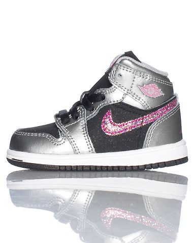 the best attitude 3ba1c 5ec29 JORDAN Mid top infant toddler sneaker Lace closure Padded tongue with JORDAN  jumpman logo Glitter affiliate NIKE swoosh on sides of shoe Cushioned sole