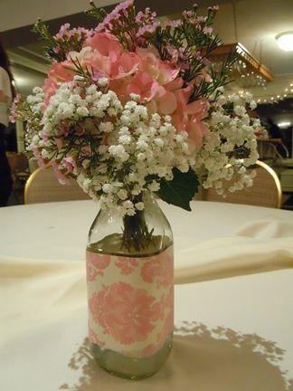 Wedding centerpiece; milk bottle floral centerpiece