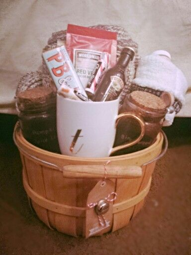 This wasn't hard and turned out so cute! Winter survival kit:  warm blanket, fuzzy socks, cute mug, red velvet hot chocolate mix, bailey's to spike it, chocolate bar, holiday flavor Chapstick, mini hand cream, 2 homemade sugar scrubs- pumpkin spice latte and gingerbread.