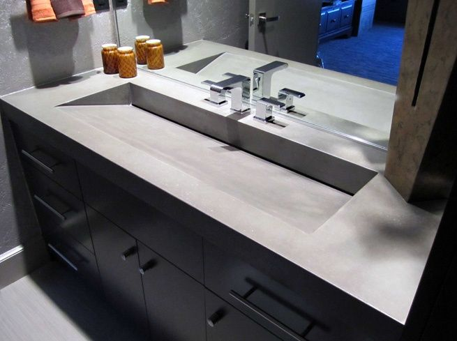 Concrete countertops...interesting. I love the shape of the sink as ...