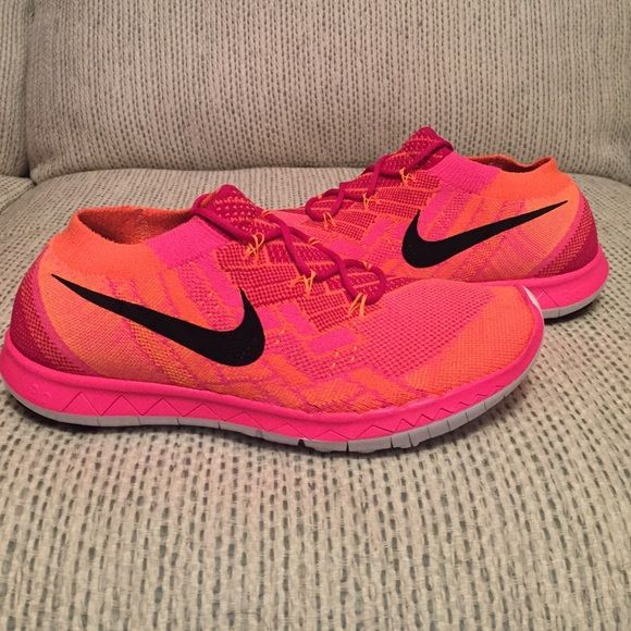 the latest 7e205 f13de NIKE FREE 3.0 FLYKNIT Nike Free 3.0 Flyknits in neon pink orange black- I  have two sizes (7.5, 8) Brand new from Nike, they come in a half box (lids  removed ...