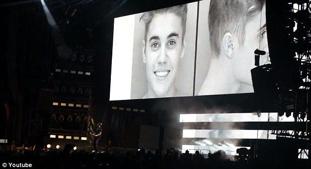 Beyonce and Jay-Z's On the Run tour feature Justin Bieber's mugshot as background visual