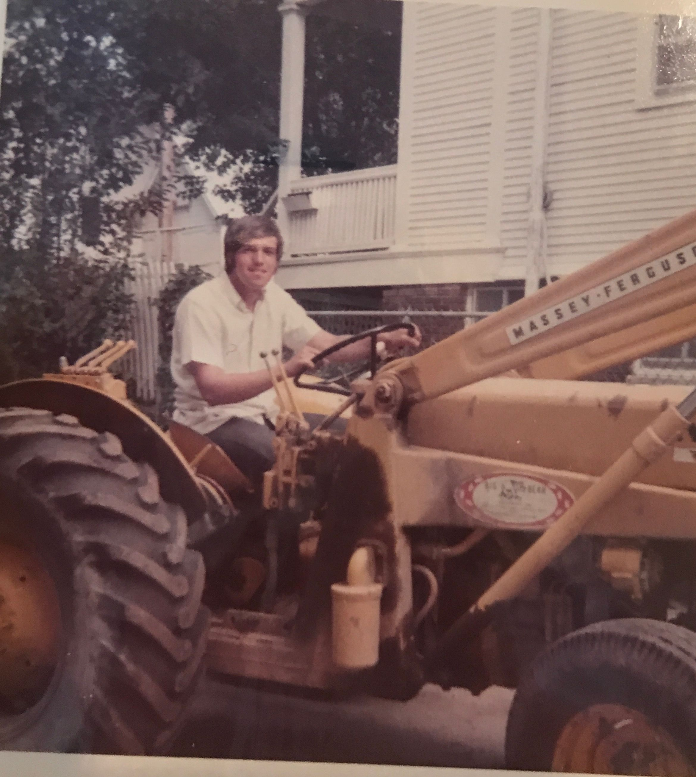 Bill driving front end loader to build retaining wall and patio at