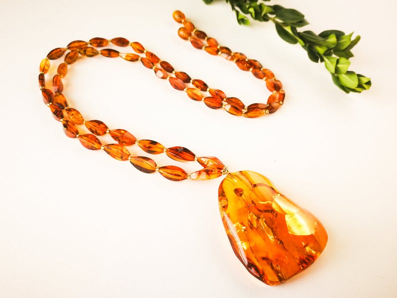 intense orange amber pendant with silver Natural amber royal cognac color unique twisted oval shape pendant shiny cognac amber pendant