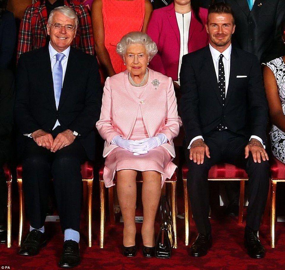 David Beckham cuts a dapper figure at Buckingham Palace