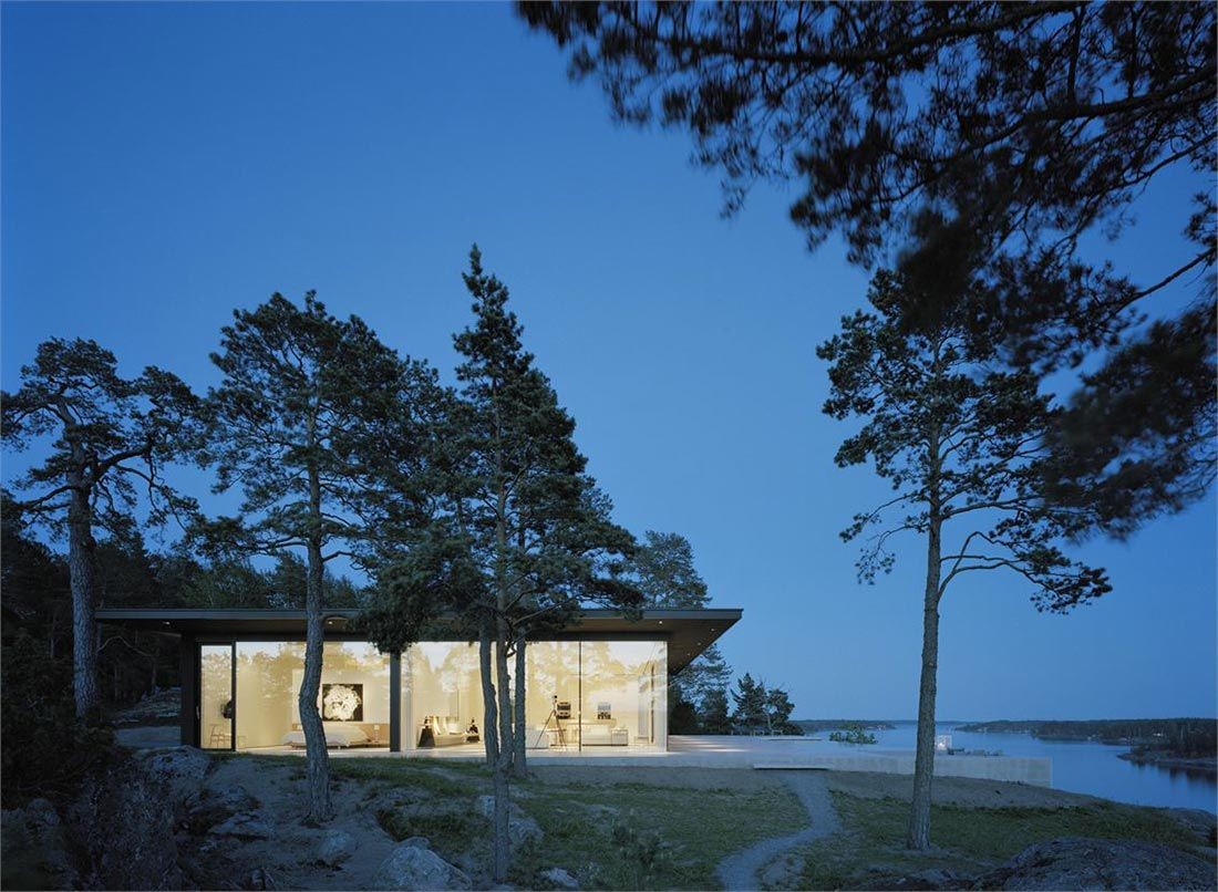 Evening lights view stunning lake house in sweden