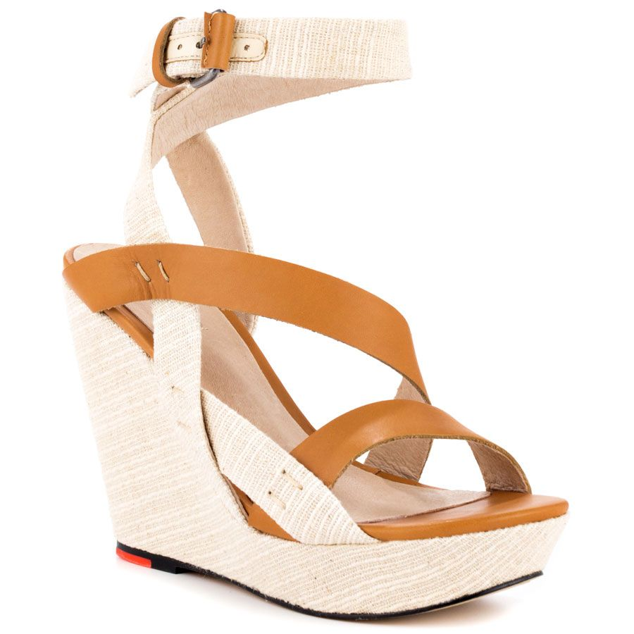 Joe's Jeans - Karla  Price: $115  Everyday will be a runway when you have the Karla on. This Joes Jeans sandal features a natural fabric upper wrapped with cognac leather straps. Adding height to this style is a 4 1/2 inch wedge.