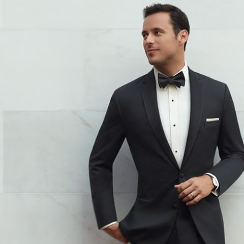 A black tuxedo complemented with a white shirt and is a classic look for  formal occasions.