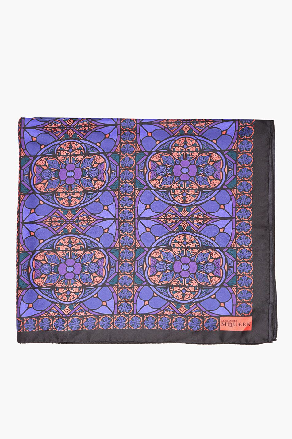 "ALEXANDER MCQUEEN //  Indigo Silk Stained glass Print Scarf  32259M010013  Square silk scarf in black. Stained glass print throughout in indigo, purple, and red. Logo print at corner. Tonal stitching. Approx 34"" x 34"". 100% silk. Made in Italy.  $340 CAD"