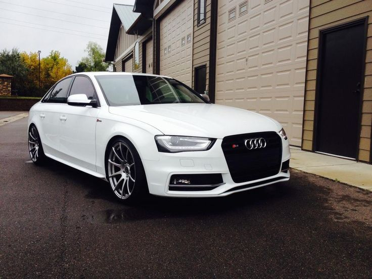 s4 with mesh grill, white out headlights and nice color wheels