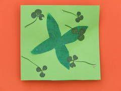 Use pressed shamrocks to decorate your St Patricks Day kids crafts.