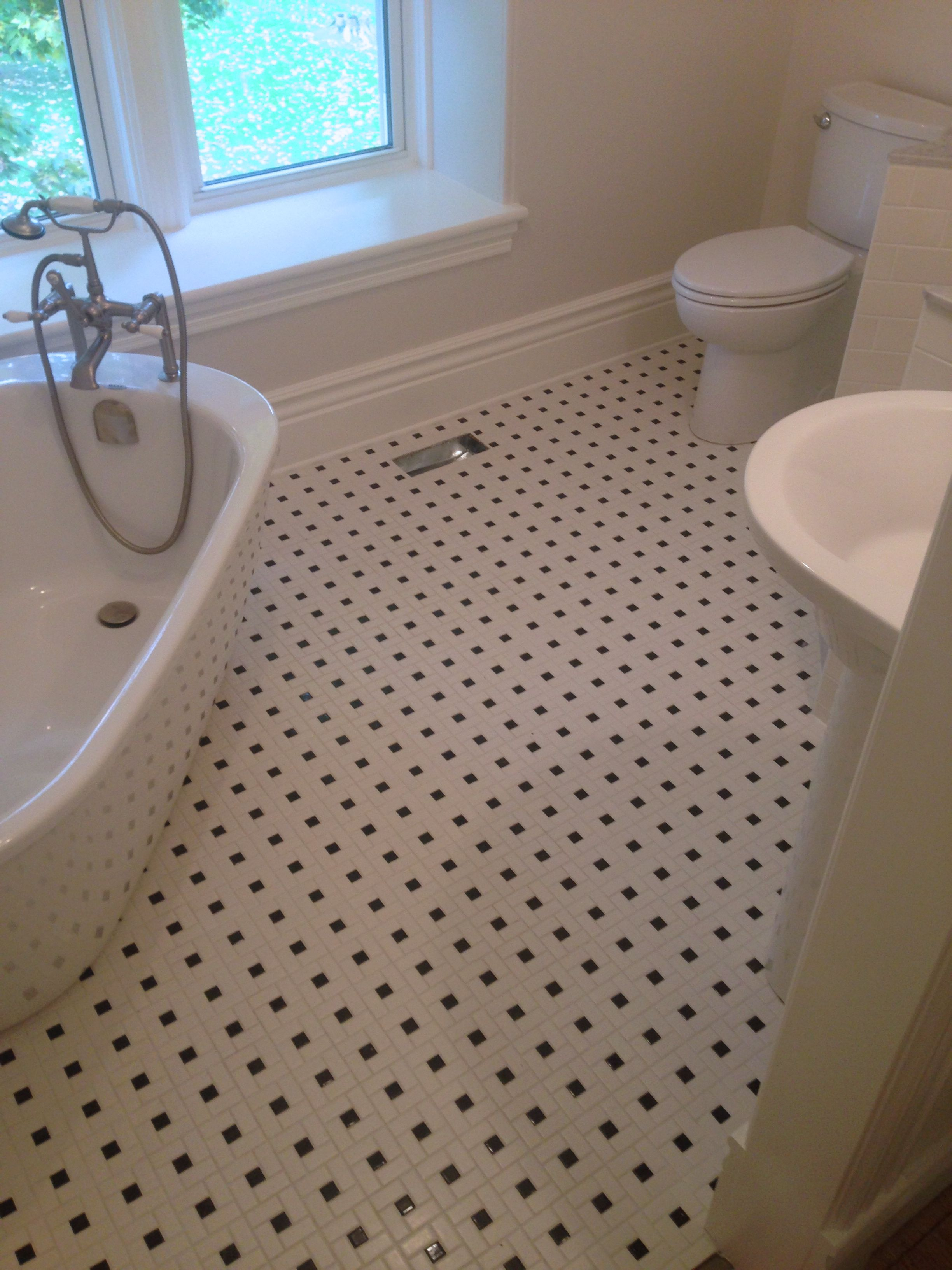 A classic black and white pinwheel tile master bathroom for Master bathroom flooring