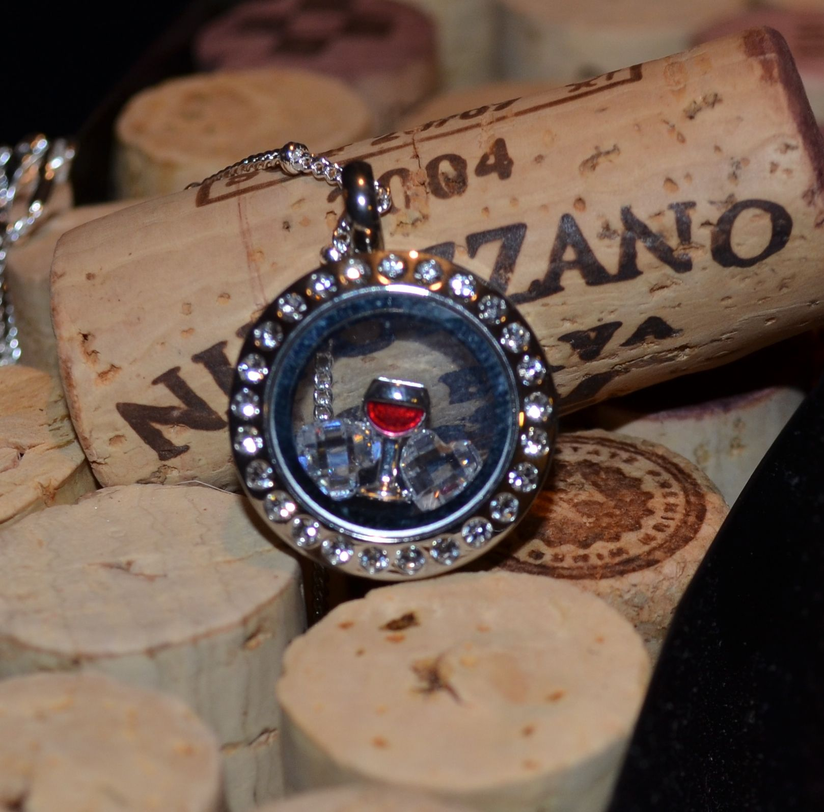For the wine lover! Mini silver locket with wine glass charm and 2 crystal heart charms.
