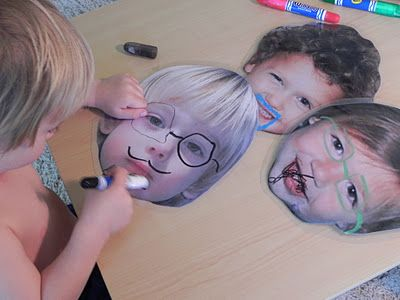 laminated faces with dry erase markers. So funny.