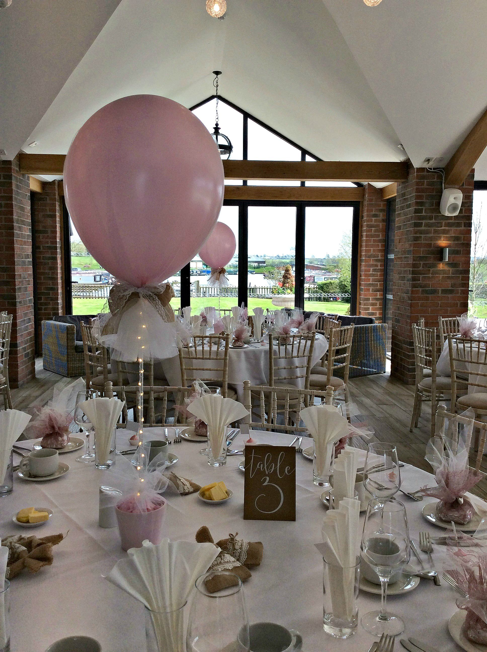 Wedding decorations tulle and lights  Tulle covered balloon centre pieces finished with hessian and lace