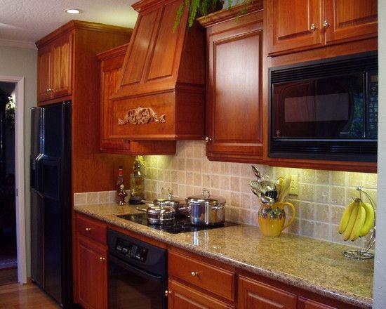light granite, darker stained cabinet, wood floors. I ...