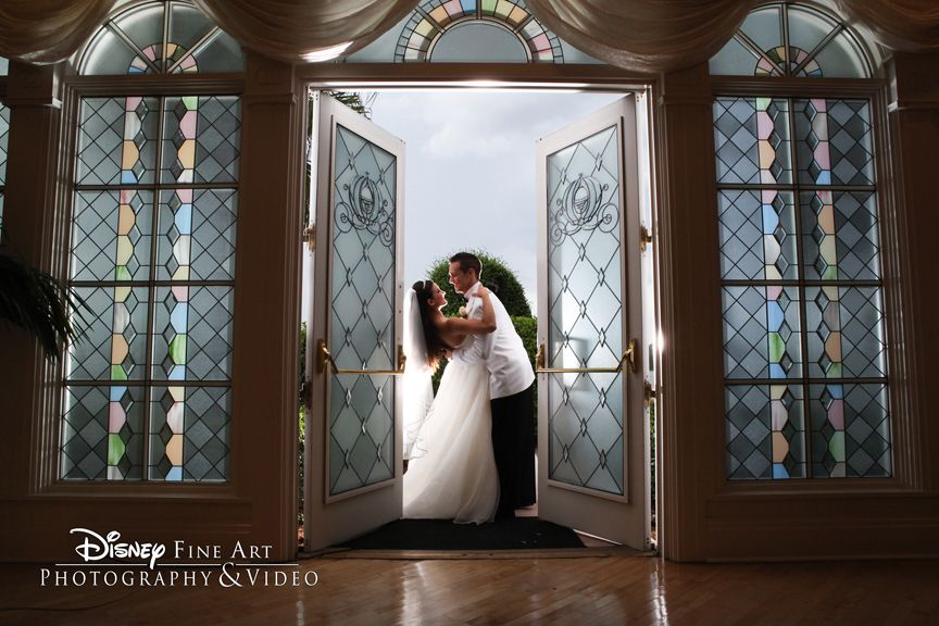 Couple shares a sweet moment between the doors of Disney's Wedding Pavilion #Disney #Wedding #Pavilion #photo