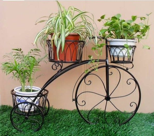 Using Flower Pots In Flower Beds Wrought Iron Tricycle Flower