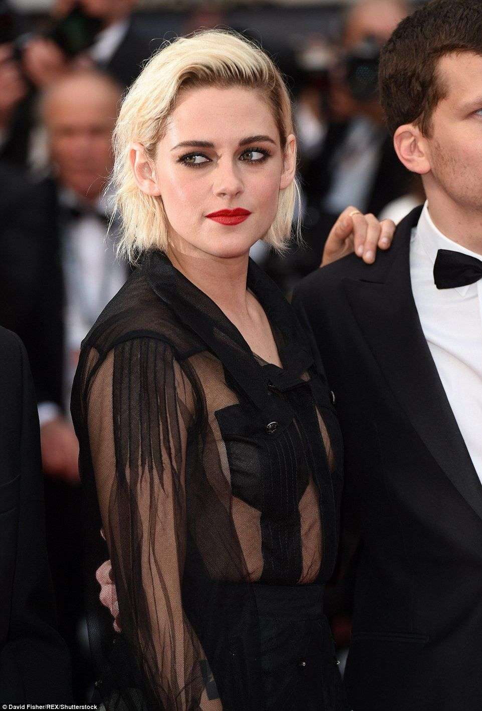 Edgy: Kristen's platinum blonde bob and a slick of scarlet lipstick perfectly complemented her red carpet ensemble