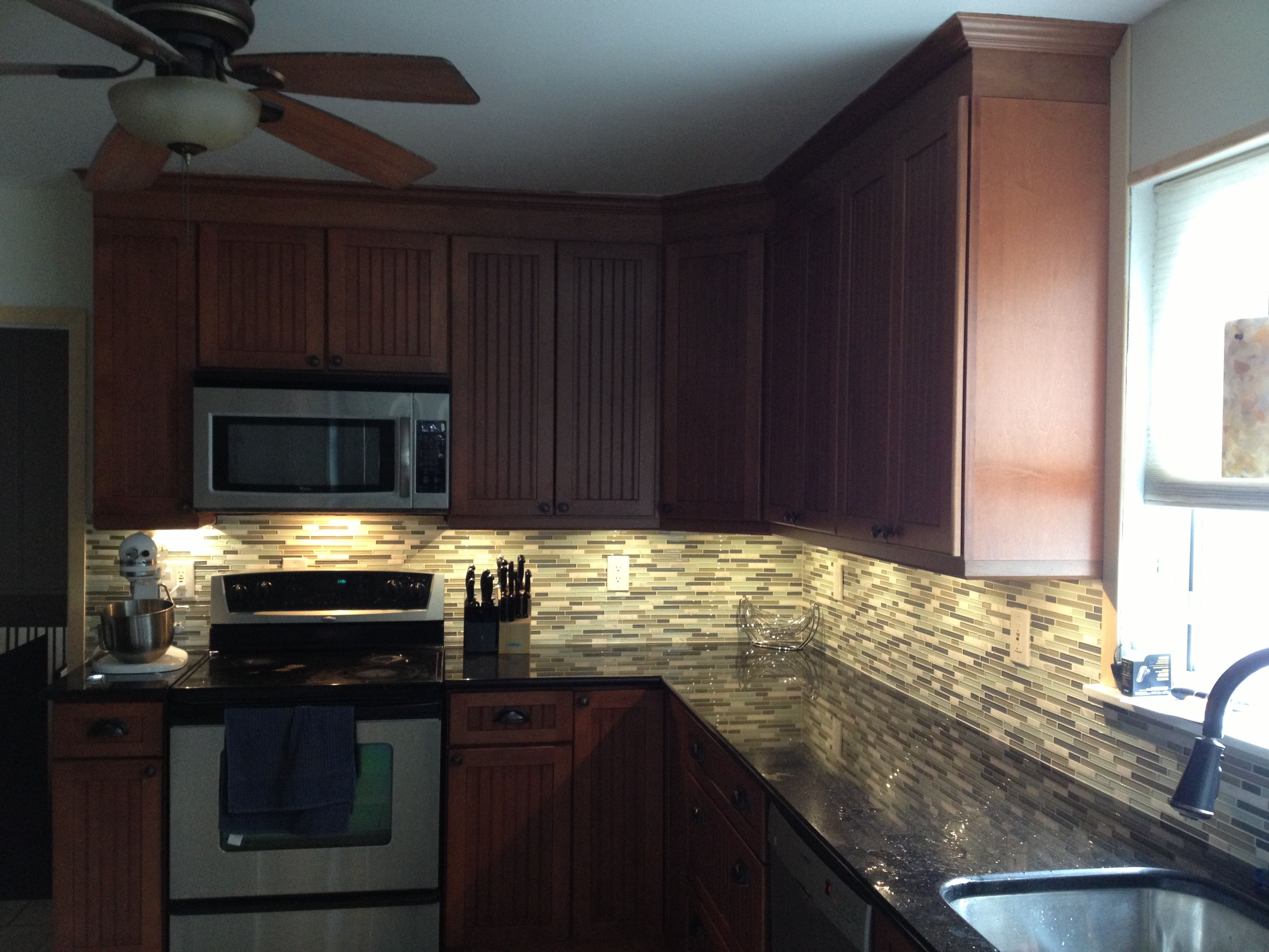 Kraftmaid maple cinnamon cabinets with black galaxy ... on Backsplash Maple Cabinets With Black Countertops  id=84523