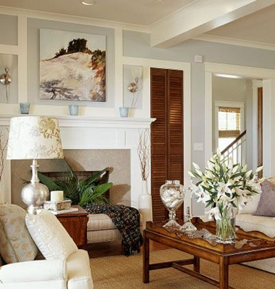 pale blue walls; off white furnishings; white woodwork; warm brown wood furniture