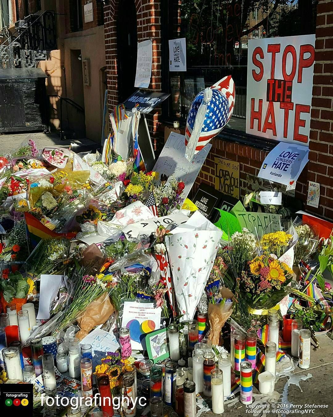 Photo by @fotografingnyc: Walked past the Stonewall Inn on the way to the train this morning to find the growing memorial. #WeAreOrlando