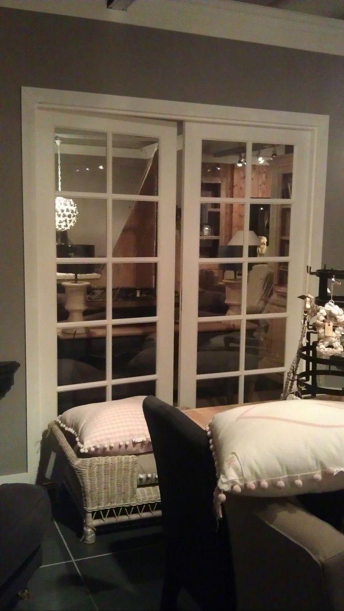 Stalen taatsdeur tussen keuken en woonkamer. kijk voor meer foto's ...