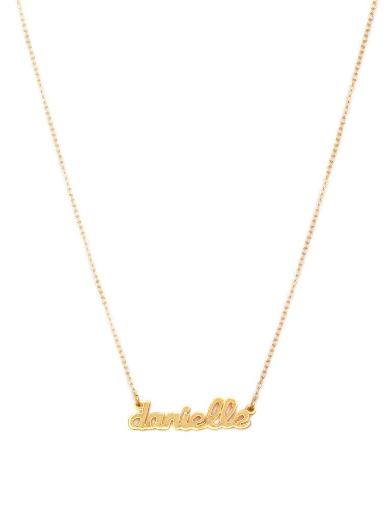 Remember the classic nameplate pendant, with it's touch-chic allure?  It's been reimagined in a sweetly miniature size for a look that's decidedly feminine.  Whether you choose to show off your own moniker or give some prime real estate to a loved one, this delicate piece is perfect alone or for layering, and is sure to be an item you will reach for again and again. Our customizable pendants let you select chain length, and metal color, so you can be sure this piece will be made just for…