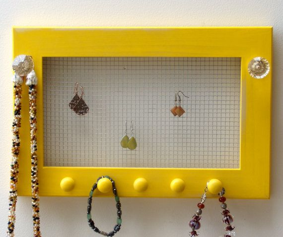 chicken wire behind frame - good idea for hanging center necklaces ...