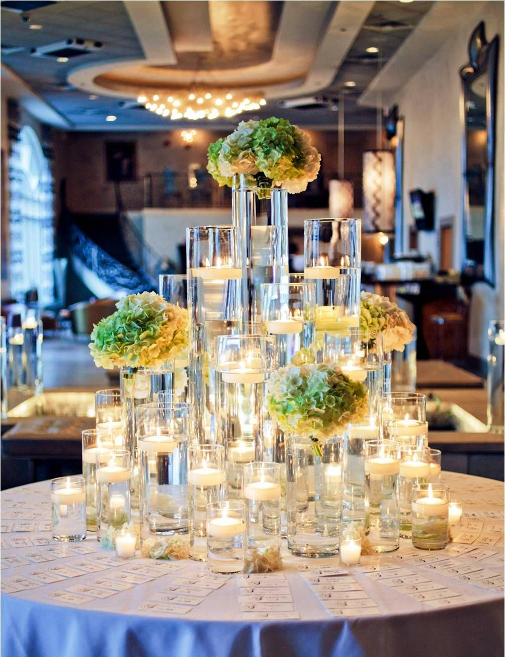green and gold hydrangea with tall glass cylinders and floating candle light   flowers  wedding