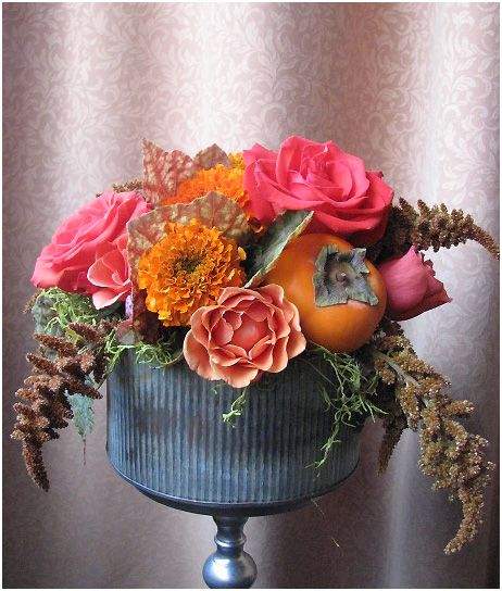 Fall table arrangement by Vibrant Flowers in Portland, Oregon with peach roses and persimmons