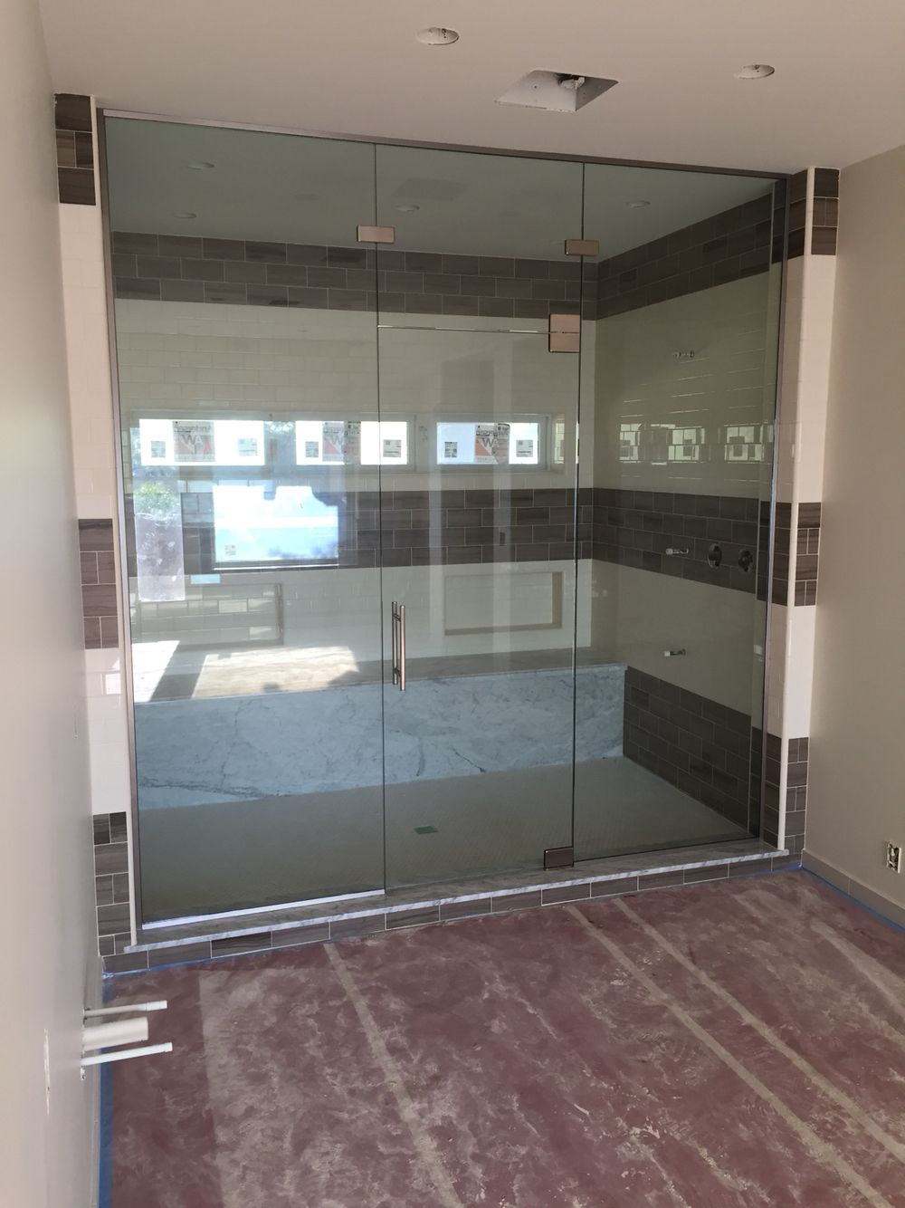1 2 Panel Door Panel With Fixed Transom Above Chrome Hardware With Pivot Hinges Hinged Off The Transom Grand Custom Shower Doors Shower Doors 2 Panel Doors