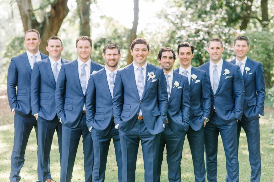 Groom and his 8 groomsmen in navy blue suits from Suit Supply in the ...