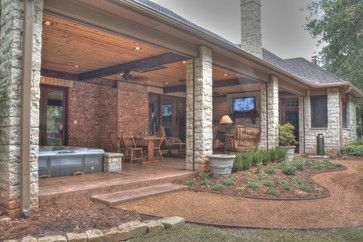 Add-on patio to create an outdoor living space complete with hot tub, fireplace, tv and full kitchen.