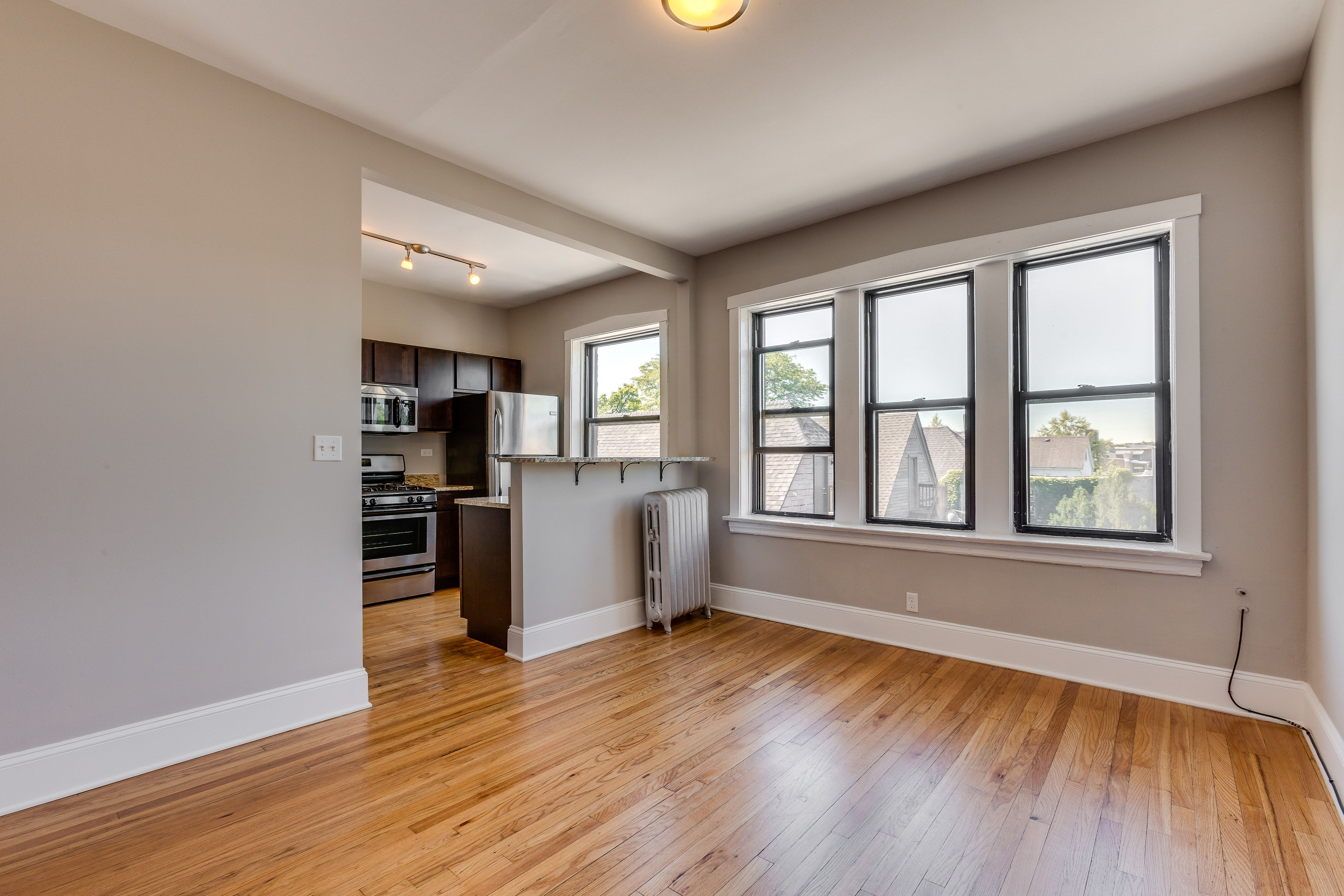 Renovated Apartment In Logan Square Chicago With Hardwood Floors Natural Light Crown Molding Modern Apartment Apartment Interior Design Rustic Kitchen Design