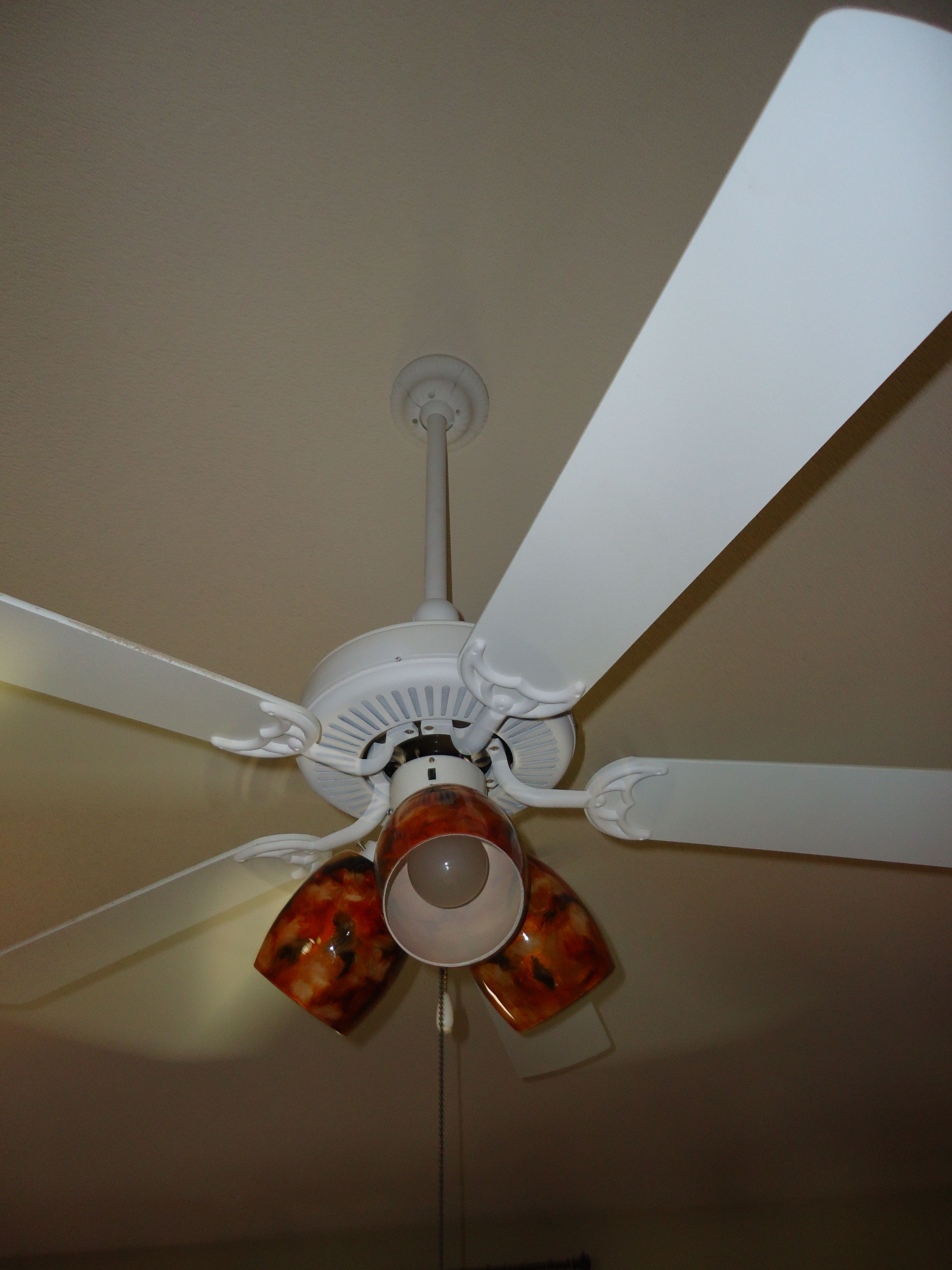 Updated ceiling fan = flat white over all of the brass