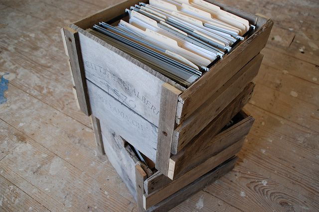 Organization 101: DIY File Crates From Pallets - DIYdiva..... Make a lid and upholster it maybe add some wheels and TADA you got some ottomans for extra seating too!