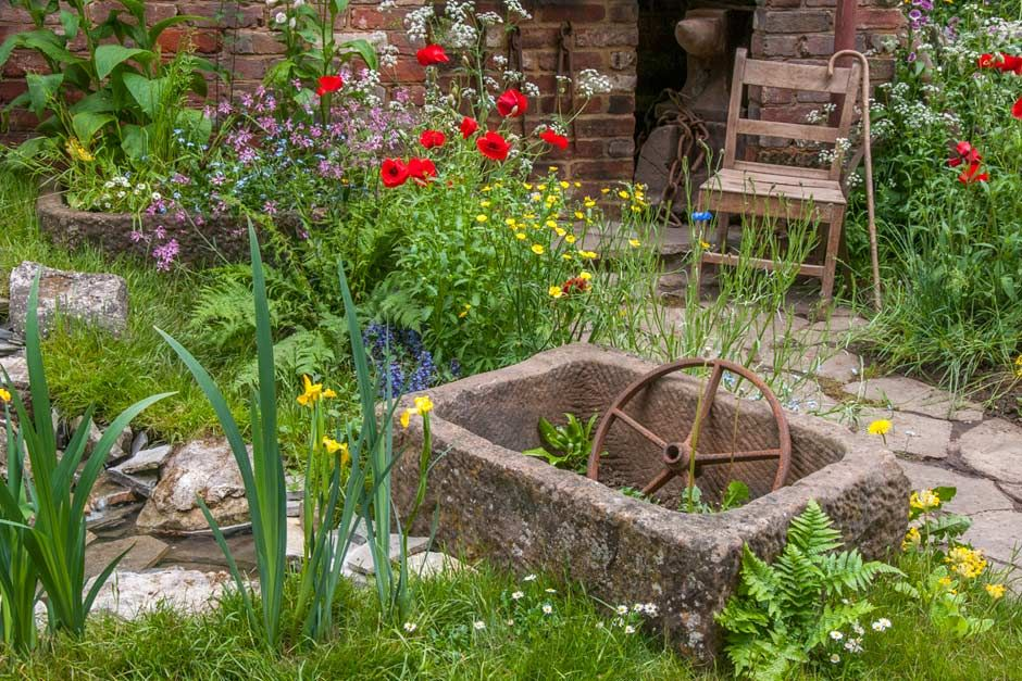 the old forge artisan garden at the rhs chelsea flower show 2015 rhs gardening - Rustic Garden 2015