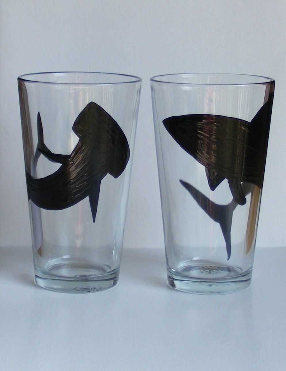 Set of 2 Shark glasses, Pilsners have a Hammerhead on one and a Great White on the other.
