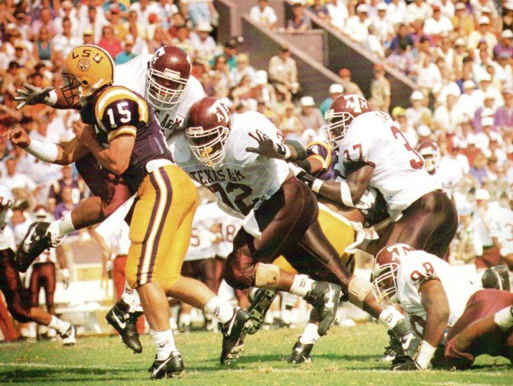 The Lsu Quarterback Is Swarmed By The Aggie Wrecking Crew Defense Including Eric England 92 Larry Jackson 37 And Otis Nealy Lsu Lsu Quarterback Aggies